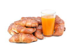 Croissant and a glass of juice Stock Photography
