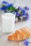 Croissant and glass of milk Royalty Free Stock Photos