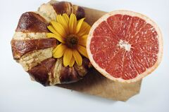 Croissant and grapefruit Royalty Free Stock Image