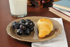 Croissant, grapes and milk Stock Image