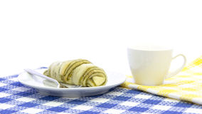 Croissant green tea  bread with cup of coffee breakfast on table. Mat and white background Stock Photo