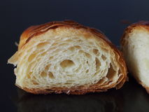 French croissant half, black surface Stock Photography