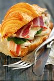 Croissant with ham and cheese close up. Royalty Free Stock Image