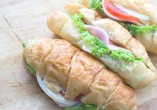 Croissant ham cheese. Closeup croissant ham cheese sandwich stock photos