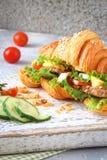 Croissant ham sandwich with fresh lettuce, egg, tomato, cucumber stock photos