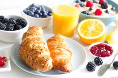 Croissant and healthy breakfast on white table Royalty Free Stock Photo