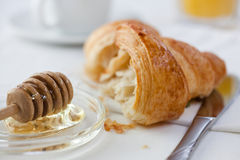 Croissant with honey Stock Image