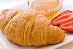 Croissant with Honey Stock Photo