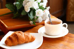 Cup of tea with french croissant Royalty Free Stock Images