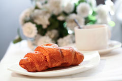 Cup of tea with french croissant Royalty Free Stock Photo