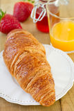Croissant with jam Stock Images