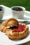 Croissant & Jam. French croissant with strawberry jam stock photo