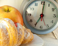 Croissant with jam and an alarm clock Stock Images