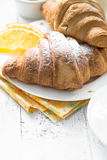 Croissant jam coffee orange jice at white wooden table. Stock Images