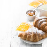 Croissant jam coffee orange jice at white wooden table. Royalty Free Stock Photography