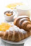 Croissant jam coffee orange jice at white wooden table. Royalty Free Stock Photo