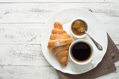Croissant jam coffee at white wooden table. Royalty Free Stock Photo