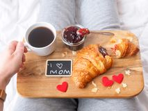 Woman with breakfast in bed royalty free stock photos