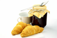Croissant and jam in a glass pot Royalty Free Stock Photos