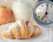 Croissant with jam and a jug of milk and an alarm Royalty Free Stock Images