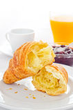Croissant with jam and juice Stock Photos