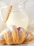 Croissant with jam and a milk jug, a light meal Stock Photos