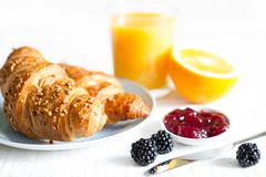 Croissant jam and orange juice breakfast on white table Royalty Free Stock Images
