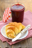 Croissant with jam on a plate Royalty Free Stock Photos