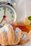 Croissant with jam and tea with a lemon Stock Photography