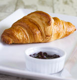 Croissant and jam Stock Images