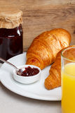 Croissant and juice Stock Images