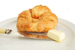 Croissant knife and butter Royalty Free Stock Images