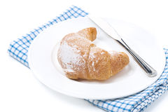 Croissant and a knife, isolated Stock Photos