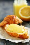 Croissant with lemon cream. Royalty Free Stock Photos