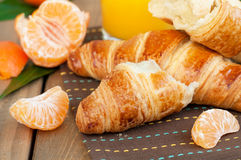 Croissant and mandarine Royalty Free Stock Photos