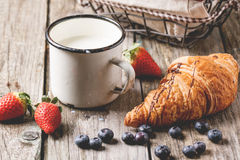 Croissant, milk and berries Stock Images