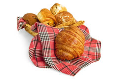 Croissant and muffins in a basket with a napkin Stock Photography