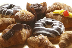 Croissant, muffins and donuts Stock Photos