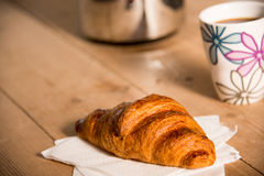 Croissant and mug of coffee Stock Photos