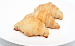 Croissant new 3 pieces of clean white plate Stock Image