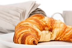 Croissant and newspaper Stock Photos