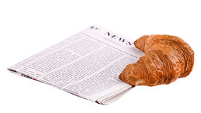 Croissant with newspaper Royalty Free Stock Image