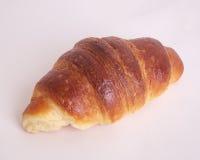Croissant no fundo branco Fotos de Stock