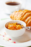 Croissant with orange jam Royalty Free Stock Photography