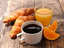 Croissant and orange juice. Coffee cup with croissant and orange juice Stock Photos