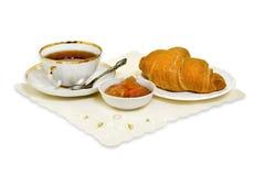 Croissant, ostruzione e tè Fotografia Stock