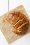 Croissant over brown paper Royalty Free Stock Images