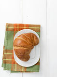Croissant over green cloth Stock Images