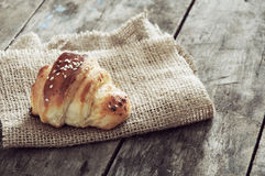 Croissant over wooden background Royalty Free Stock Photo