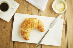Croissant pastry on white dish Royalty Free Stock Photos